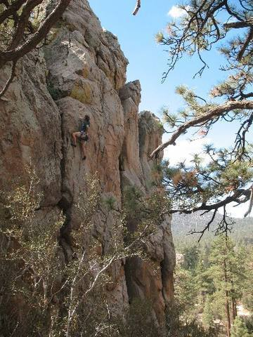 Phil at the crux of Bum Steer (5.10a), Holcomb Valley Pinnacles.