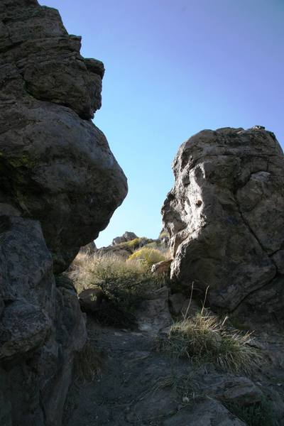 The gap between 4th and 5th boulders.