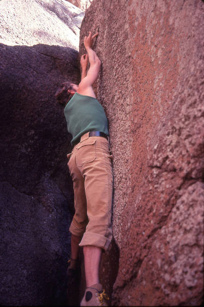 """Scott Baxter on the crux one-finger undercling move on his test-piece """"Tunnel Boulder"""", Uptown Mt Elden (Donini was never able to get this one!)"""