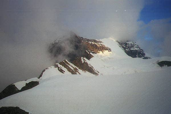 Robson and the Kain Face in the distance.  The ridge to the left was descended to avoid the ice fall.