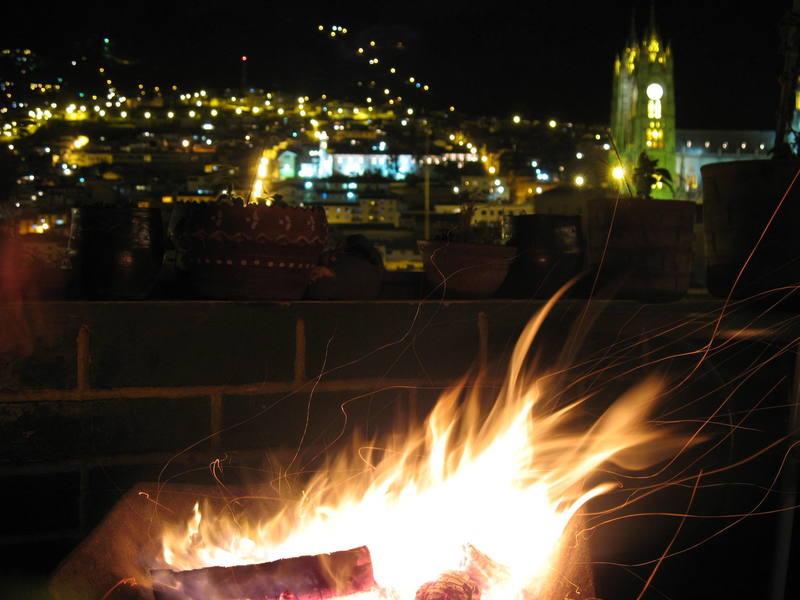 Wheelbarrow bonfire on the 5th floor terrace of the Secret Garden hostal, Old Town Quito, Ecuador.