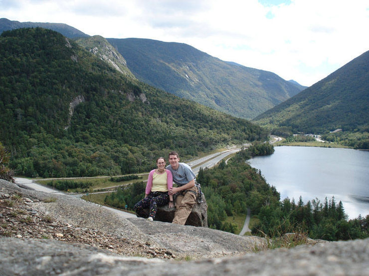 A great view of Franconia Notch and a very cute couple, haha... you can see Echo Crag and a few other cliffs in the back ground... Cannon Cliff is around the corner to the right...