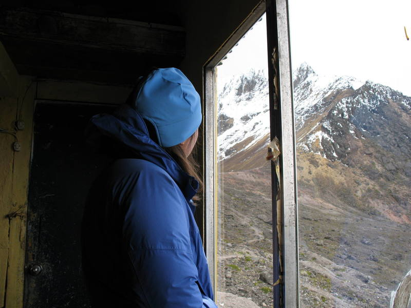 """Nancy Bell planning tomorrow's climb of Illiniza Norte from the cold """"comfort"""" of the refugio."""