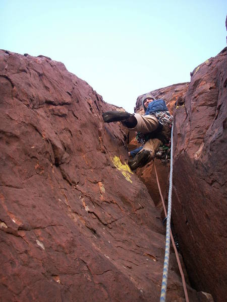 Andrew Gomoll leads up the primo second pitch chocolate rock and lime-colored lichen.