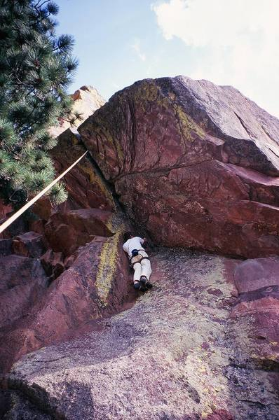 Joseph Crotty gets ready to start up the roof of 'Far Out' (5.10d) on the back side of Ridge-2 in Skunk Canyon (Flatirons). Photo by Tony Bubb, 8/07.