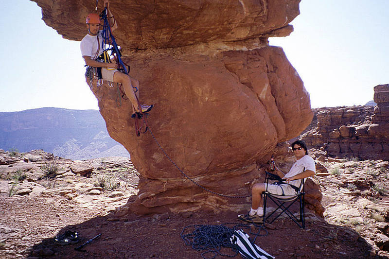 Avery Nelson on the Happy Turk, (Moab, UT), with Andrew Gram belaying from the beer-lounger.