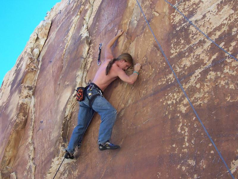 Michael Kimm on the first ascent of Pornographic Priestess.