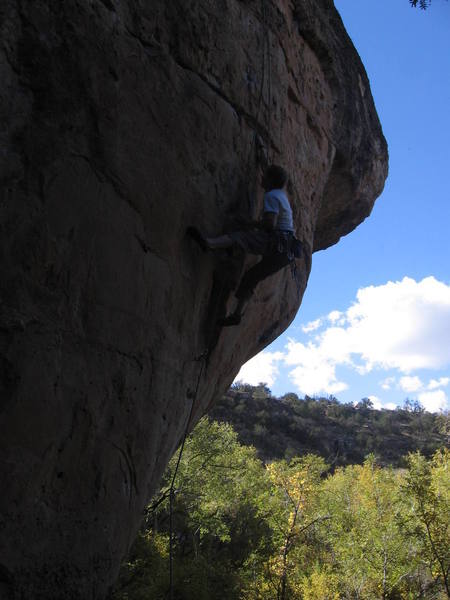 Bored of Inquiry - Swiss Wall 12b<br> The crux, powerful bump from mono to jug in break