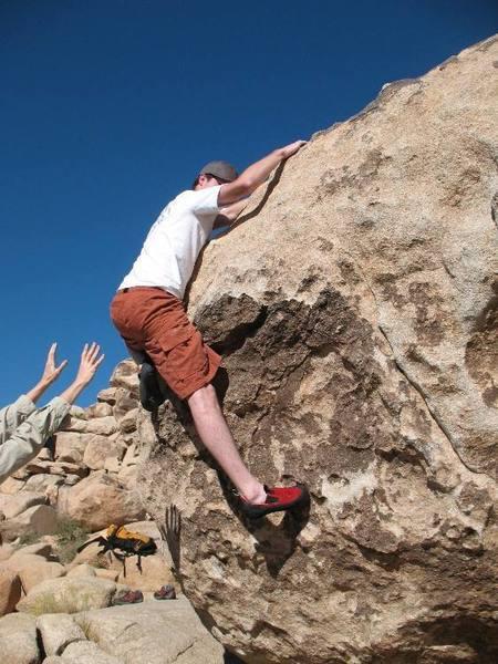 Working the slopers on Platypus (V0), Joshua Tree.