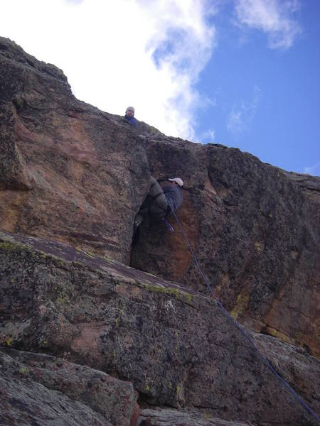 Brandon heel hooking while I belay at the rod.