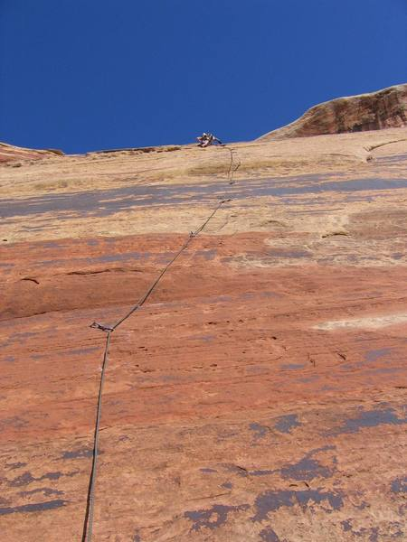 Stepping high into right-angling seam (hidden from view).