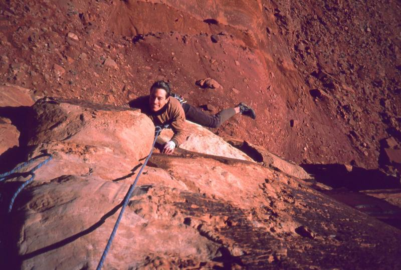 Tony Bubb climbs Lightning Bolt Cracks (5.11) on Indian Creek's North Six Shooter. This was done in Joseffa's approach shoe after arriving and realizing I'd forgotten my climbing shoes. Photo by Joseffa Meir, 2002.