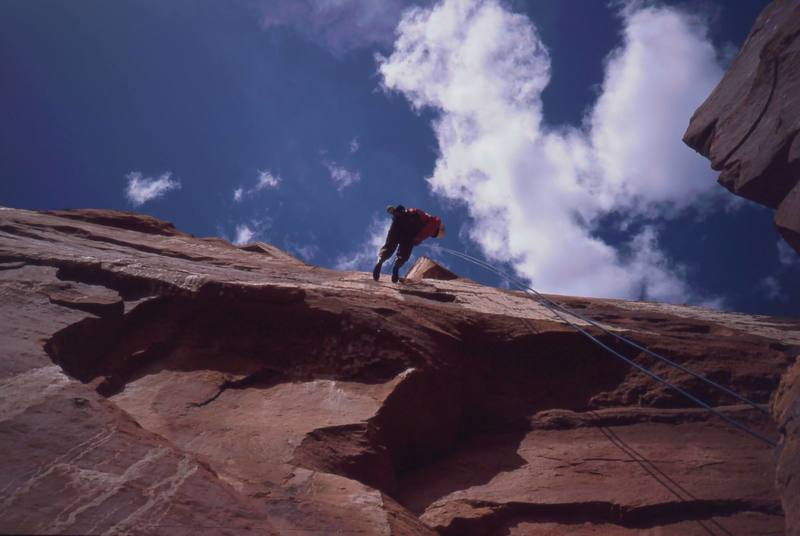 Joseffa Meir raps down from the summit of 'The Priest' in Castle Valley. Photo by Tony Bubb, 2003.