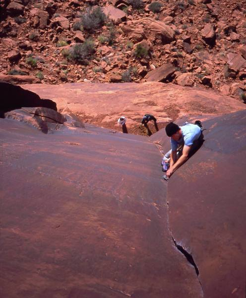 Josh Janes just getting started on 'Ice Cream Parlor Crack (5.11a). Photo taken from the anchors by Tony Bubb, 2004.