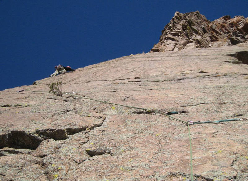 Climbing the awesome steeper-than-it-looks-in-this-photo arete on pitch two of The Odyssey.  The face right of the arete is very clean and begging for an FA.