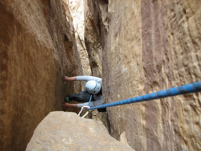 Maura Hahnenberger coming up the first pitch chimney on Desert Guardian during the first ascent.