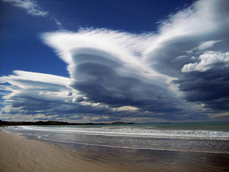 This is the stuff good vacations are made of.  White sands, blue-green water, and stunning clouds at Moereki Beach on the east coast of the South Island, just north of Dunedin.