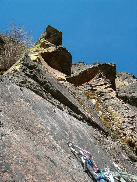 The roof on the Left is The Dragon 5.12? <br> Roof on Right is Buddha's Belly 5.11a
