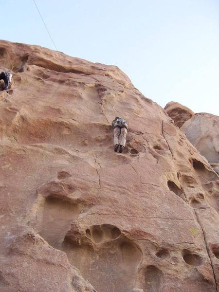 Climber (right) working his way up the route.