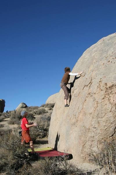 Julie enjoying the slabby face of Ranger Rock.