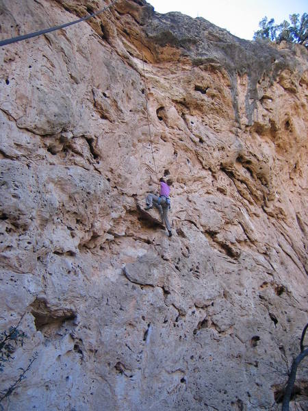 High on the featured travertine of the Rosebud Wall.  The rock is very sharp, with plentiful holds.  The rock on Big Horn is much more monolithic.