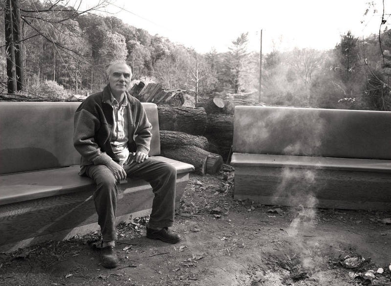 Miguel Ventura, owner and founder of Miguel's in the Red River Gorge, sitting by last night's fire.