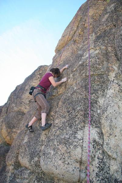 Julie cruising after the crux of Step Child, 5.8