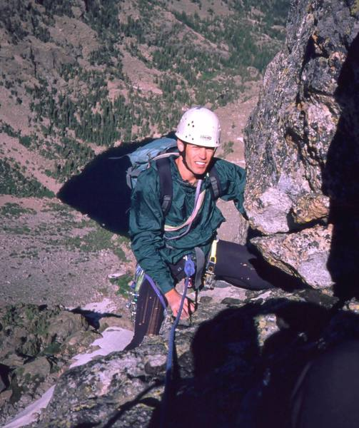 Tony Bubb summits on the Direct Middle Buttress (5.9) of Hallett Peak. Photo 1998 by Rich (?).