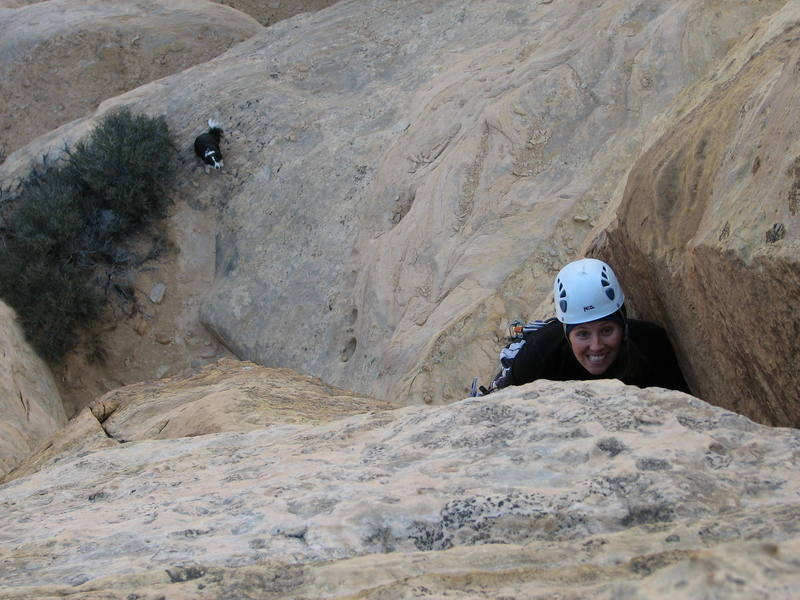 Maura on the first ascent of Hermits Hovel Tower- Mystery Incident.  Rosco is looking on from below.