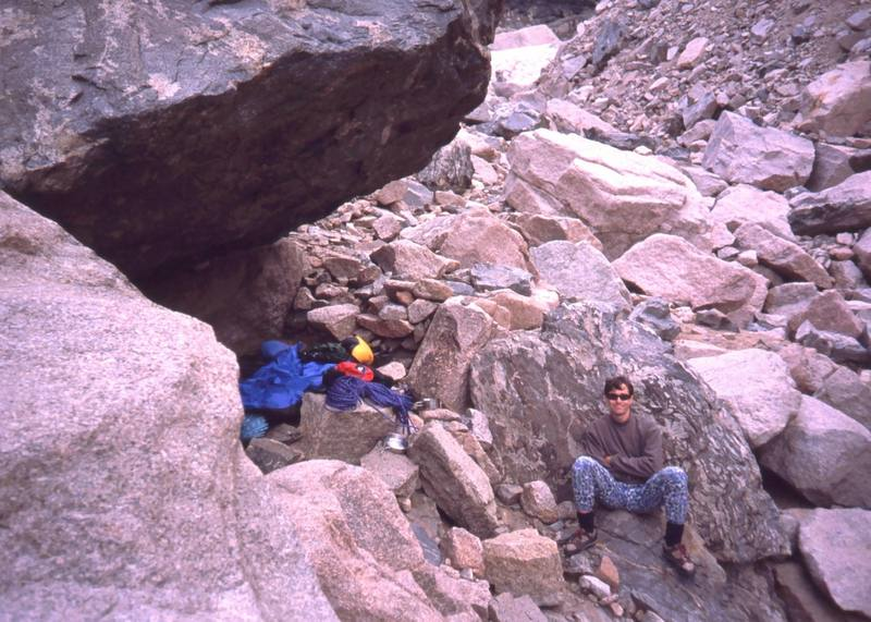 A typical bivy in RMNP. Find a good overhanging rock and hope it stays dry. This one is up above Chasm Lake and is good for hitting the Diamond via Alexander's Chimney. Photo by Joseffa Meir, 2001.