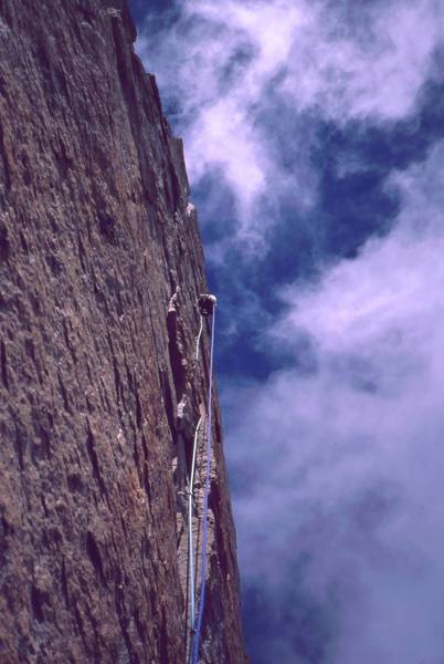 Joseffa Meir leads above on the sea of Granite that is encountered on any Diamond route. Photo by Tony Bubb, 2001.