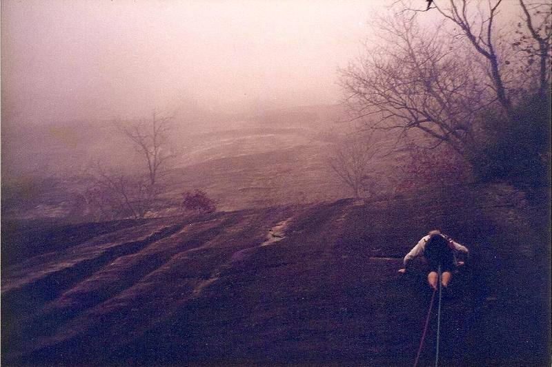 Starting up the run-out 1st pitch into a sea of mist... circa 1994