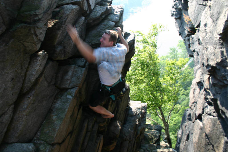 Brain Roland, free climbing above anchors bare foot.