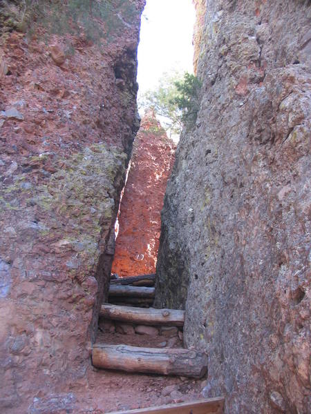 "Natural hallway with large wedged steps dubbed the ""Route Canal"".  There are a few shady routes on the left side (Big pine wall)."