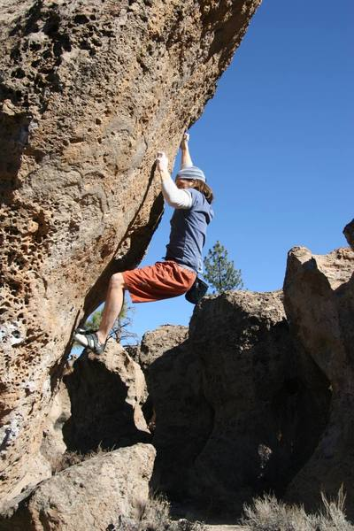 Sticking the crux move on Looks Like We're One Horse Shy Partner, V5