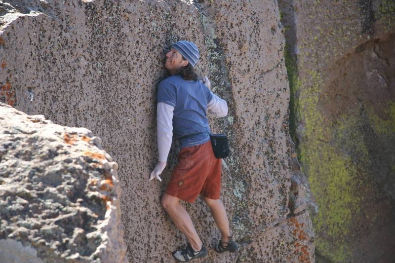 Midway through the crux sequence on, Ride the Very Thought to the Ground - V1