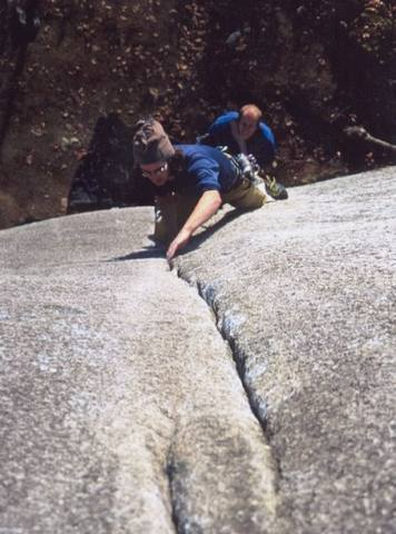 Nearing the switching cracks crux on Crime of the Century.  Photo of Connor Reynolds by Matthew Buckle, used with permission.