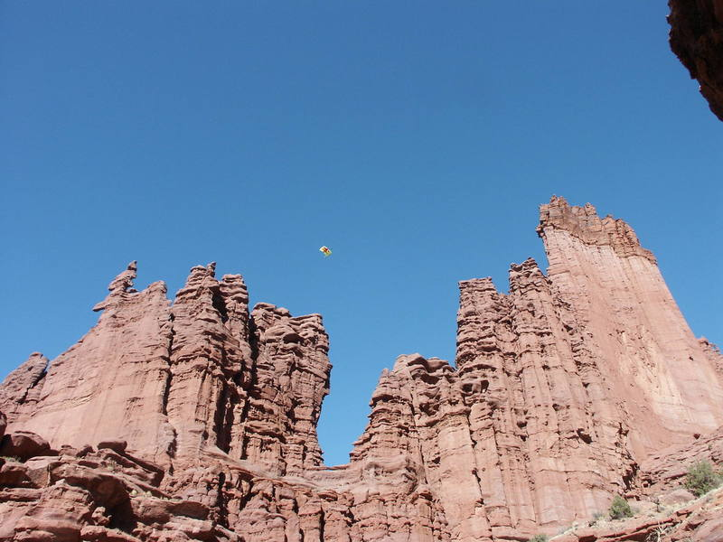 """Jimmy P. (next is Wayne C.) after base jump from the """"diving board"""" on the rim rock - crazy sight. . . ."""