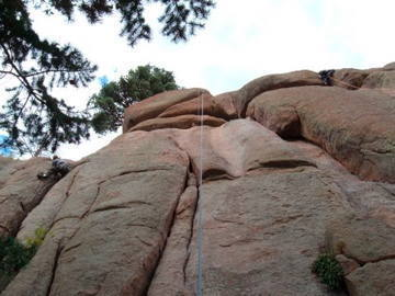 Photo of Aaron atop Reefer Madness, Turkey Perch, South Platte.  The double cracks to the left of the rope.