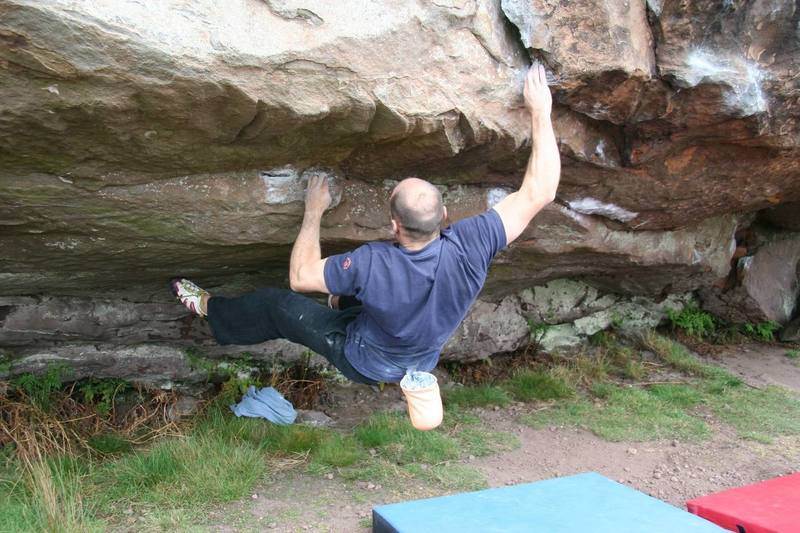 Reaching out to the lip of Cave Central RH, V5