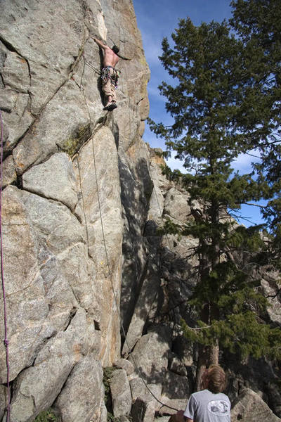 Mark climbing to the left of Grins to get a start for Last Laugh.<br> <br> Photo: Dave Fiorucci.