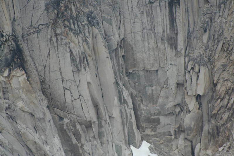 Climbers on the crux pitch of McTech Arete. This photo was taken from the south summit of Snowpatch Spire using a telephoto lens.