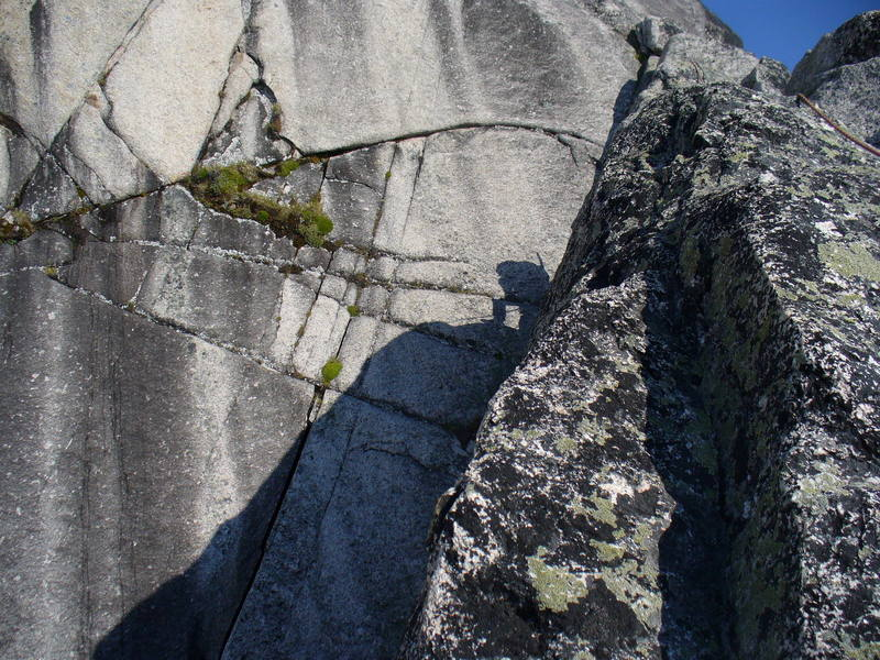 Here I am (in shadow) belaying on one of the lower pitches of the Snowpatch route, Snowpatch Spire