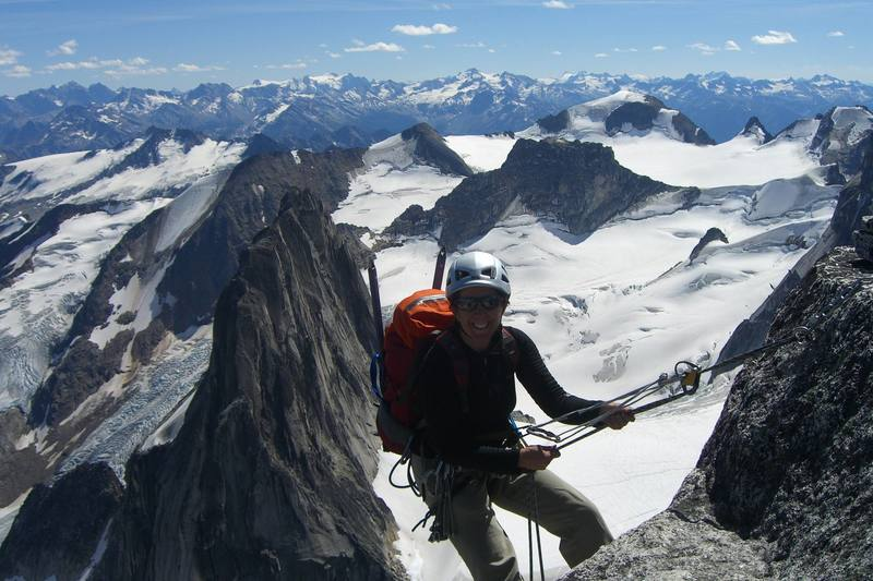 Rapping off the top of Bugaboo spire after climbing the NE ridge.