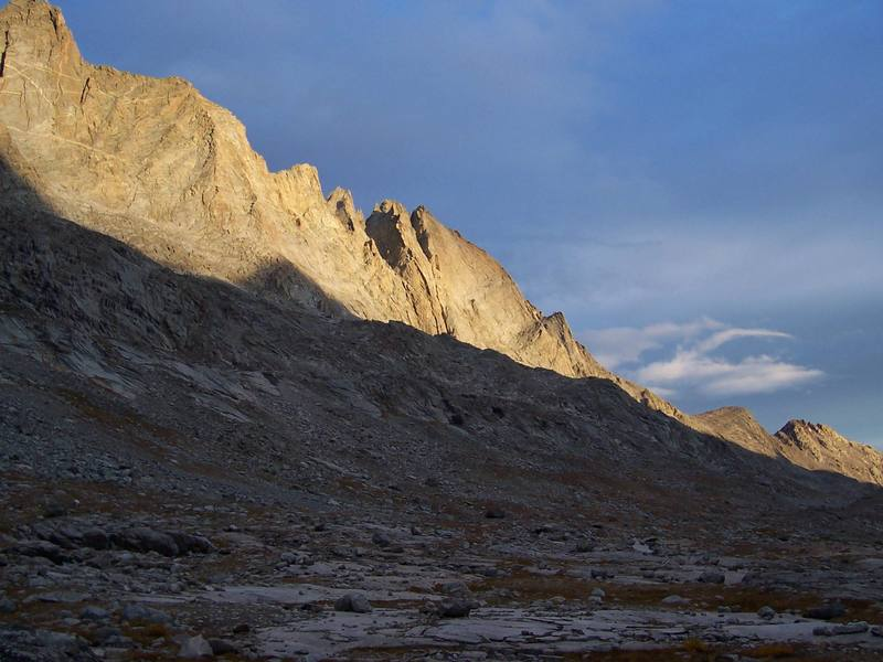 The steep west face of Fremont Peak.  A few routes ascend these tall buttresses and faces.  To the left and in the foreground is Mt. Sacagawea.