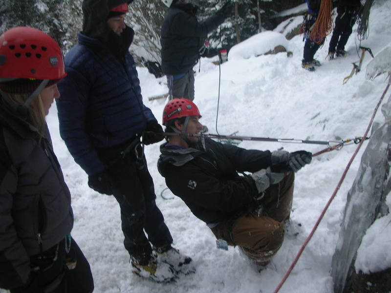 Rob and Dan aquaint themselves with placing and weighting ice screws in the base of Hidden Falls.