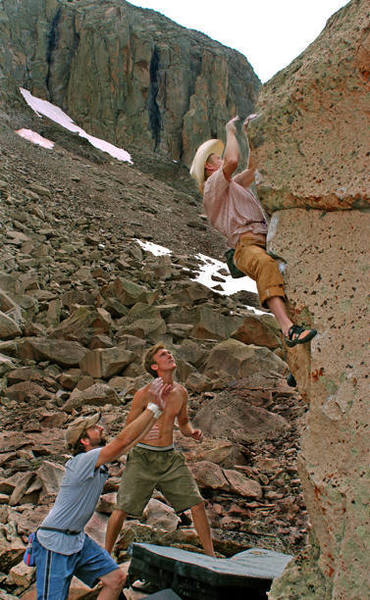 """The Larry sending an unnamed arette on """"The Gluon"""" boulder.  Zack and Andy are good spotters."""