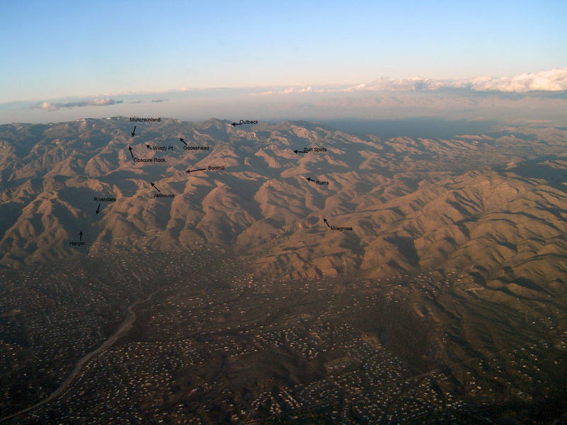Aerial photo of the East end of Catalinas. Some crags pointed out. Munchkinland is hidden, but behind the ridge pointed to. The ruins can be seen easily.