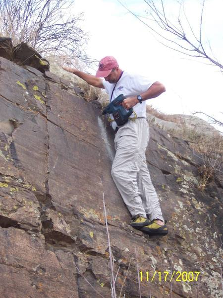 Al Simons drilling the first hole on the 'Kids Wall'