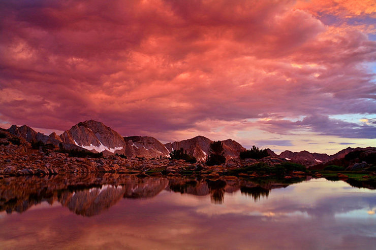 Incredible sunset after a typical Sierra thunderstorm. Taken from Dusy Basin. In the background is Mt. Giraud - July 2007